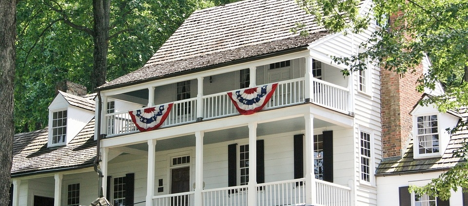 White 2 Story Home with Covered Porches