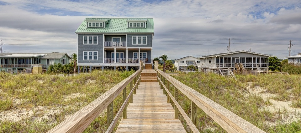 Beach Home At End Of Long Wooden SideWalk