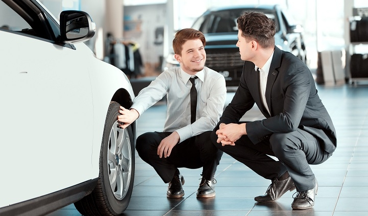 young man in dealership