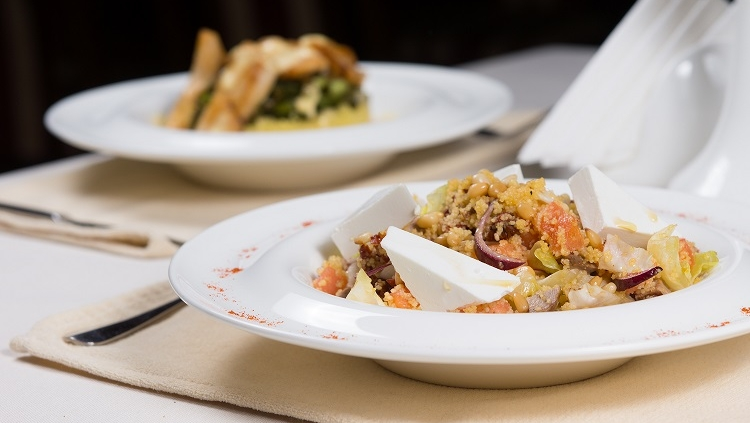 Prepared Dishes in White Bowls at Simple Place Settings Served on Restaurant Table for Two